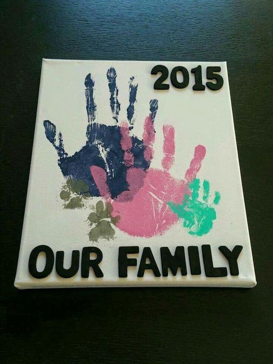 Our Family Handprints on Canvas Art including Puppy prints...so cute!
