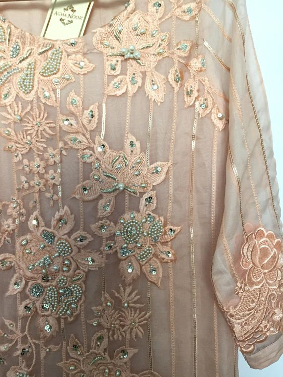 f62fc4635c Shine bright in this beautiful tea pink Agha Noor kurti. Intricate pearls  across the front makes it look very formal and you can easily pair them  with ...