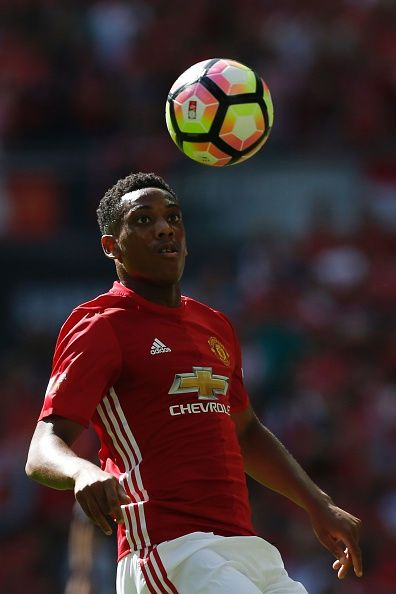 Manchester United's French striker Anthony Martial eyes the ball during the FA Community Shield football match between Manchester…