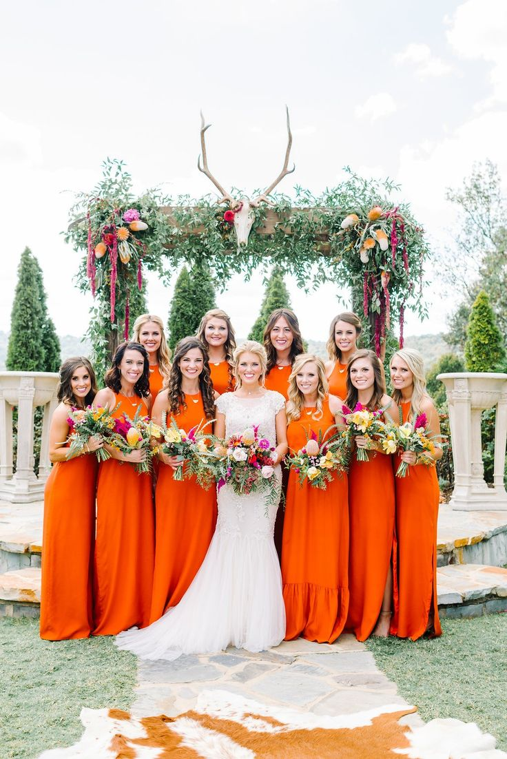 Bright and bold orange bridesmaid dresses.