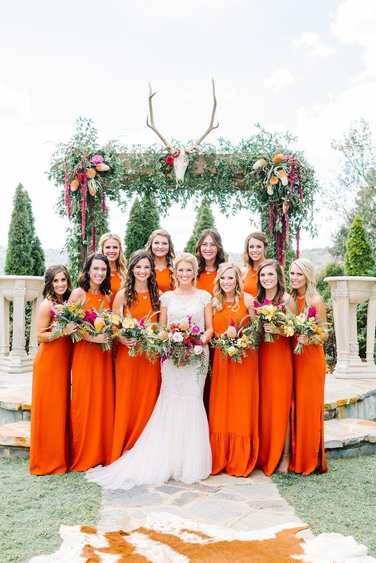 Bright and bold orange bridesmaid dresses.