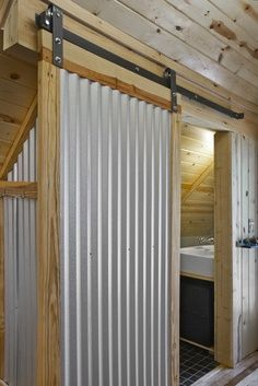 Corrugated Metal Interior Decorating | Corrugated Metal Barn Door ...  Spaces Corrugated Metal Wall