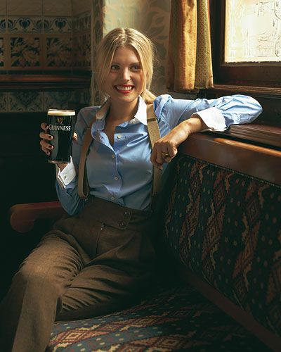Lady wearing tweed brown pants with suspenders and blue dress shirt with white collar #office #menswear #blueandbrown