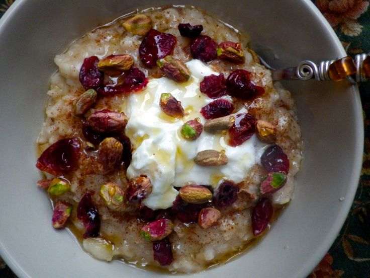 Hot oatmeal with stewed pears, craisins, pistachios, greek yogurt and honey. A comforting and sweet start to any day.
