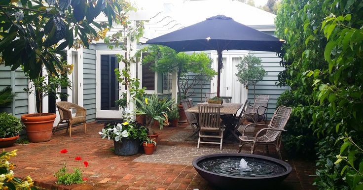 small paved courtyard with greenery - Google Search