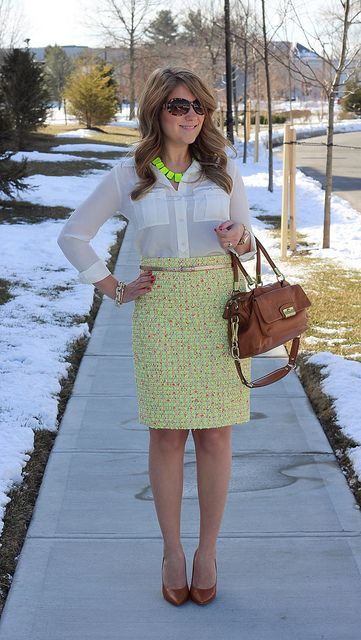 Neon tweed skirt, and amazing bright green necklace!