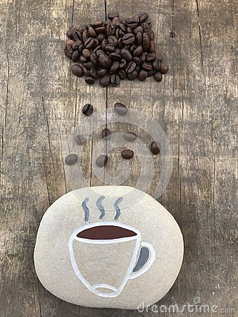 Conceptual photo with a rain of coffee beans over a stone design cup