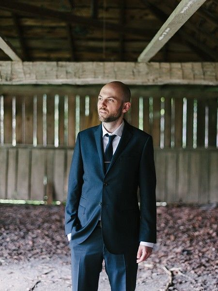 Love this shot of the groom at Black Creek Pioneer Village. Such a classic look for any venue!