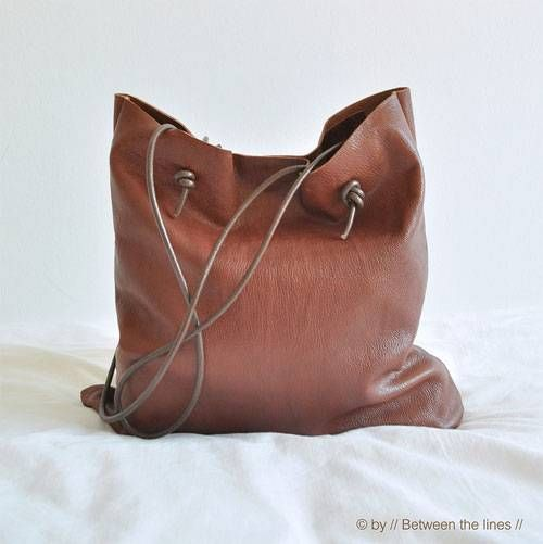 This simple leather bag is the perfect beginner project for learning to work with leather.