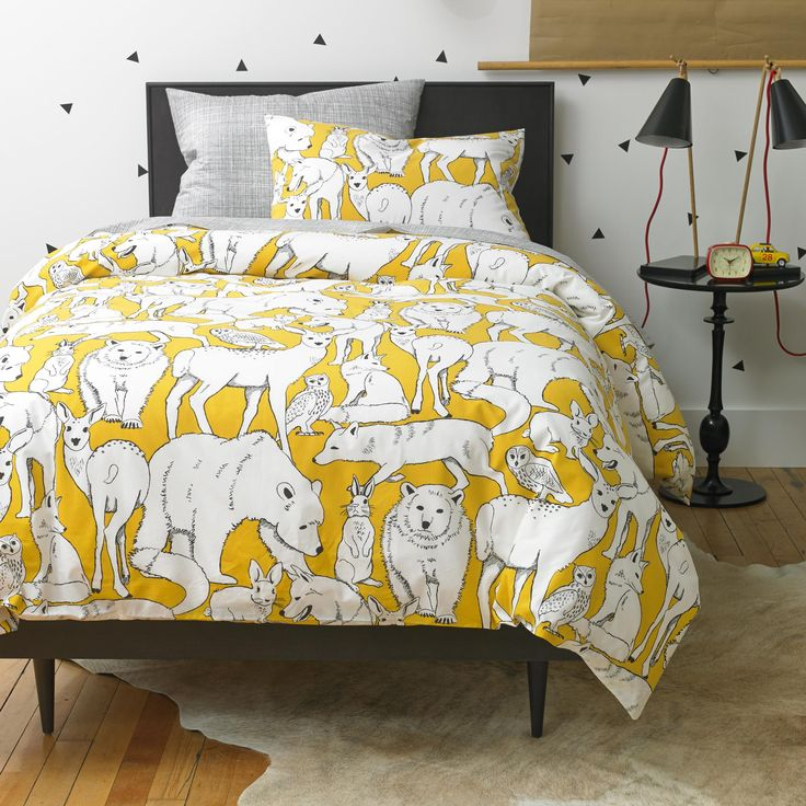 Wildwood Citrine Duvet Set | Meet Wildwood. Inspired by vintage ink drawings, we created a whimsical world with our favorite woodland animals. The vibrant background highlights the artistry of our designers in the unique, illustration style of the black and white drawing.