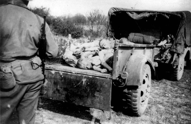 Ohrdruf, Germany, 12/04/1945, Removal of bodies in an American army vehicle.