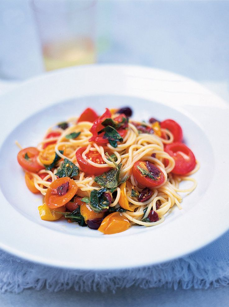 Simple Summer Spaghetti:    500 g mixed red and yellow cherry tomatoes, halved;  150 g black olives, stoned;   1 clove garlic, peeled and finely chopped;   1 tablespoon red wine vinegar;   1 bunch fresh lemon basil, leaves picked;   1 bunch fresh marjoram, leaves picked;   10 tablespoons extra virgin olive oil;   400 g spaghetti or linguine;   sea salt;   freshly ground black pepper
