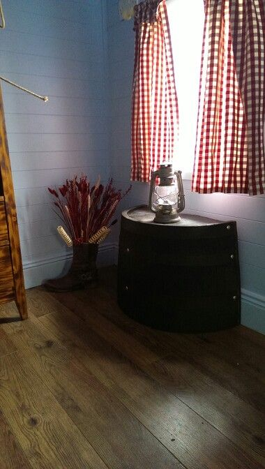 Boys playhouse, ranch themed.. i love the tilly lamp on the oak barrel.