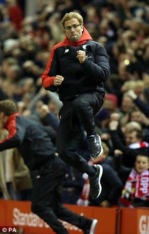 Liverpool manager Jurgen Klopp jumps with joy after Benteke netted the first Premier League goal of the German's reign on Merseyside