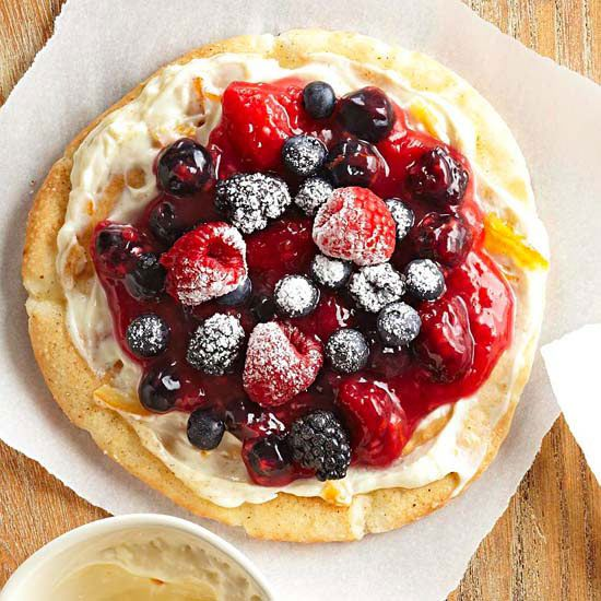 Wake up with bright Berry Breakfast Pizzas that you can put together in 25 minutes. With fresh fruit, reduced-fat Neufchatel cheese, and warm pitas for the crust, these beauties are truly a sweet start to the morning. More brunch recipes: http://www.bhg.com/recipes/breakfast/brunch/brunch-recipe-ideas/ #myplate
