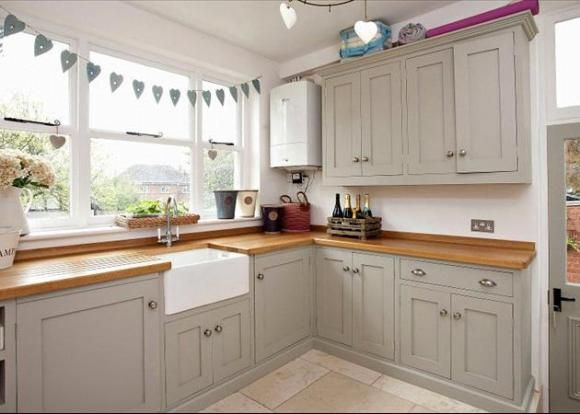 A lovely, shaker style country kitchen with framed units and wooden work surfaces. Love this soft grey paint colour too. For more like this, come and join us http:∕∕www.TheHomeDesignSchool.com∕signup where you can sign up for our free resource library, join our Facebook community and even start our free decorating e-course. We'd love to see you over there!