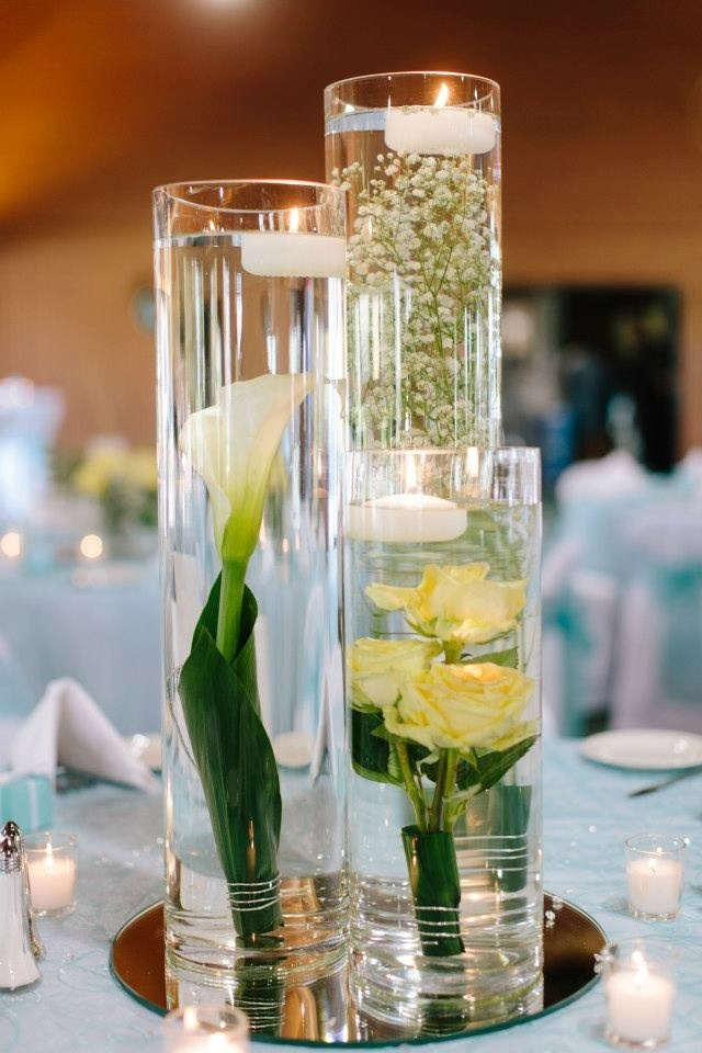 Best ideas about submerged flower centerpieces on