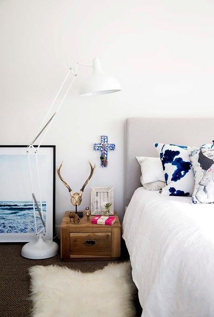 A bedside table bought in Bali about 10 years ago was sanded back for a new lease of life in this pretty room with a coastal vibe | Home Beautiful Magazine Australia