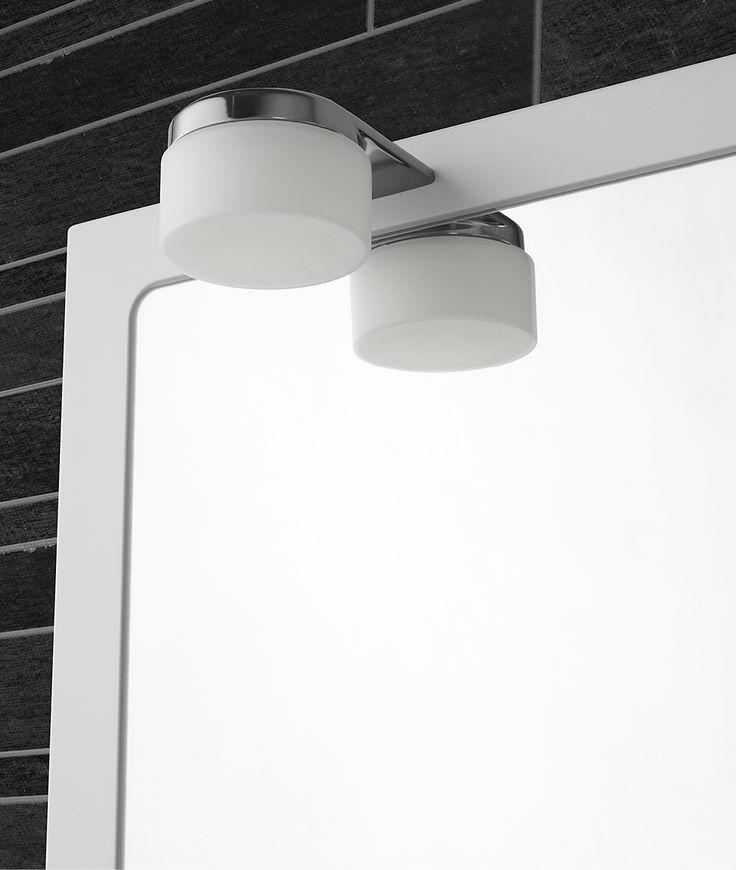 A white framed mirror with energy-saving LED lighting.