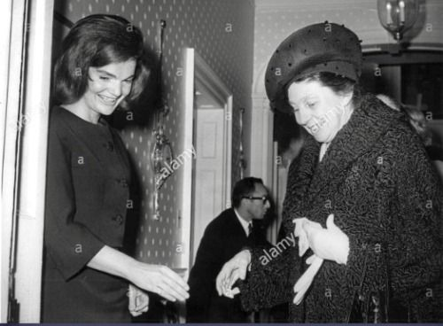 Jacqueline Kennedy welcomes Laura Carta Camprino, wife of President Antonio Segni of Italy, to her Georgetown home on January 14, 1964.