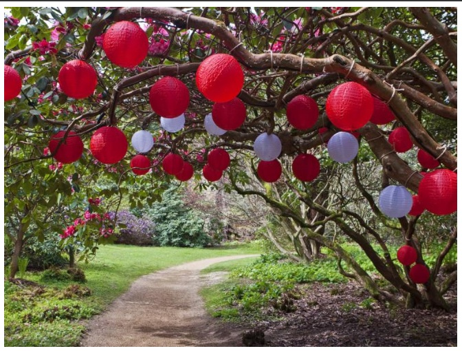 Red And White Nylon Lanterns Cover This Garden Path. Nylon Is Nice Because  They Can