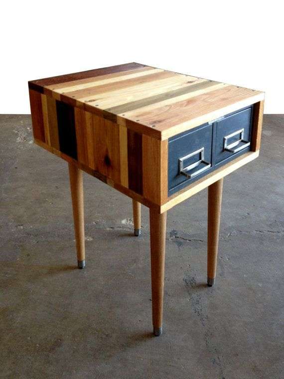 Five different species of reclaimed and oiled wood wraps a Steelmaster metal catalog drawer to create this mid-century modern inspired custom