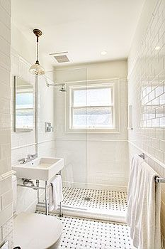 great open shower with vintage floor tile
