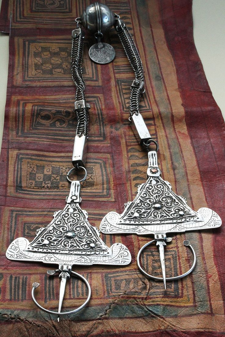 Morocco | Fibula set Ha Ha Hallmarked 1925; silver.  The coins hanging from the central pendant is dated 1321 in the Hijri calendar- 1903.  Sourced in Agdz | Price on request