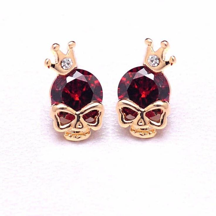 This is one of the most popular itemin our store! Skull earrings with 14K gold plating. Cubic zirconia gems in various different colors.   Available payment methods:
