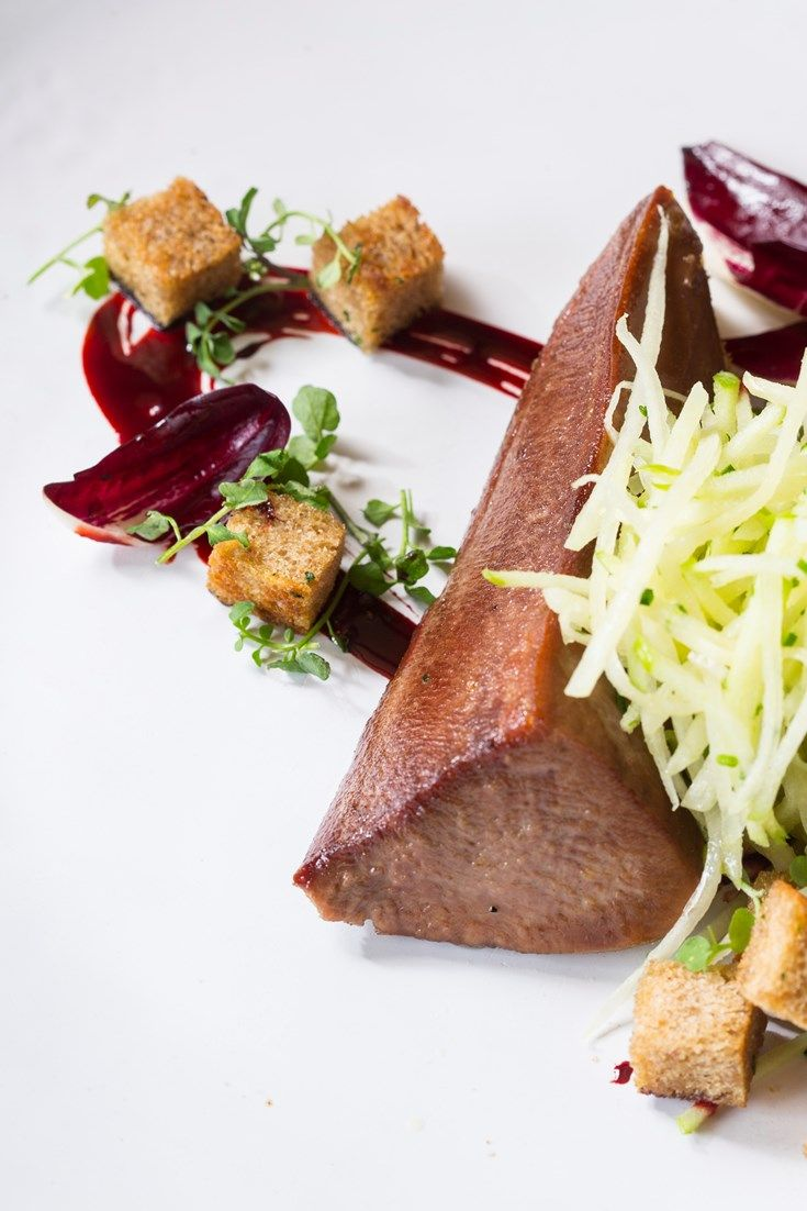 Cooked long and slow, Ollie Moore's sous vide ox tongue recipe makes a delicious meaty starter, balanced with a crunchy celeriac slaw and a tasty Marmite bread recipe as well.