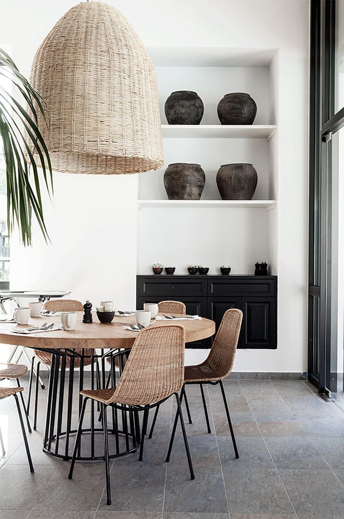 Full scale rattan woven pendant light in a dining room with a natural feel, punctuated with touches of black. Casa Cook Rhodes | © Anna Malmberg 3