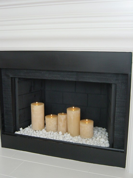 We just got a black fire place with that fake wood junk hiding the heating cans.. Maybe I will do this to keep it pretty when we dont need the heat in the summer <3