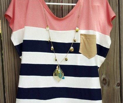 This nautical womens top is very trendy, it has classic nautical blue/white stripes, complemented by a flattering peach color-block around the fac.e