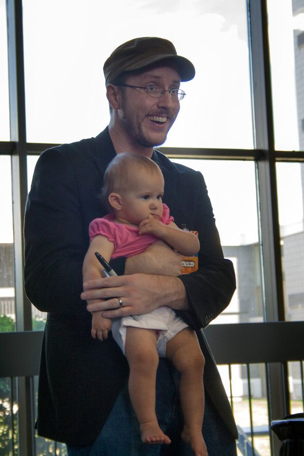He's a celebrity to me: Doug Walker, aka The Nostalgia Critic, holds a baby. Awww.