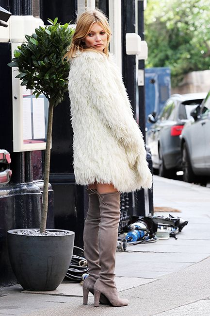 Model and icon Kate Moss looked super glam and sexy on her latest photo shoot wearing thigh high Stuart Weitzman 5050 suede boots, shaggy white fur coat and very little else on June 24th in London. Oh, the life of a model…