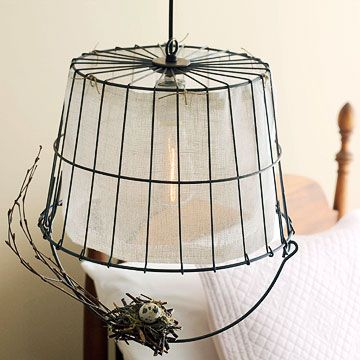 A vintage wire egg basket repurposed into a light fixture