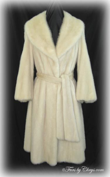 """Tourmaline Mink Coat TM779; $1000; Very Good Condition; Size range: 8 - 12. This is a gorgeous genuine natural tourmaline mink fur coat with oodles of style. It has a Simpson's label and features a large shawl collar, generous 12"""" wide belled sleeves and includes an optional matching long mink belt. It has a nice, wide sweep so it drapes beautifully and has a wide flair. fursbychrys.com"""