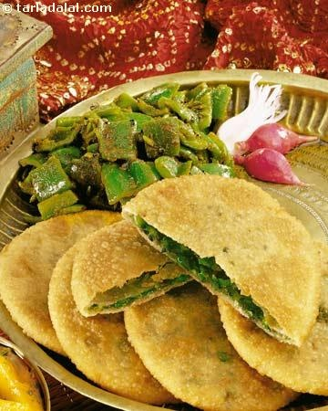 Crispy puris stuffed with green peas are superbly flavoured and simply divine. You will enjoy these puris with  Aloo ki Subji.  Puris have always been considered a treat for all occasions including the worship of family deities, birth, naming ceremony of new borns, marriages, housewarming,...