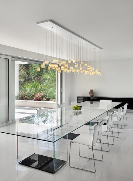 contours of the tulip chandelier complement the form of the rectangular dining table decoist - Contemporary Dining Room Light