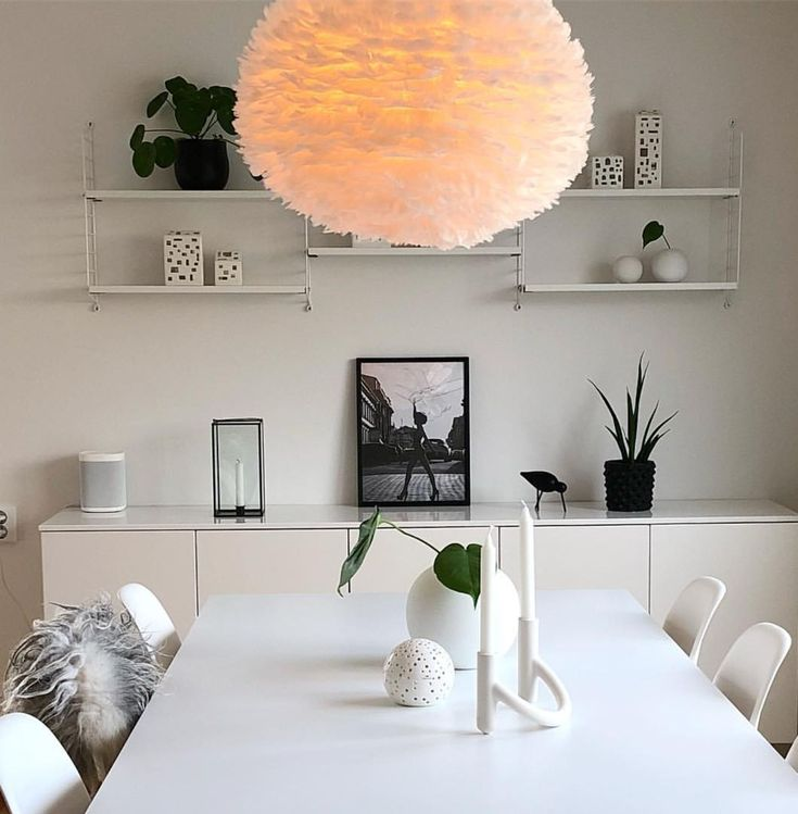 A stylish two-tone dining room from @interior_by_nina with the Eos lampshade.