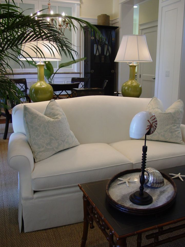 white slipcover sofa in coastal living room our boat