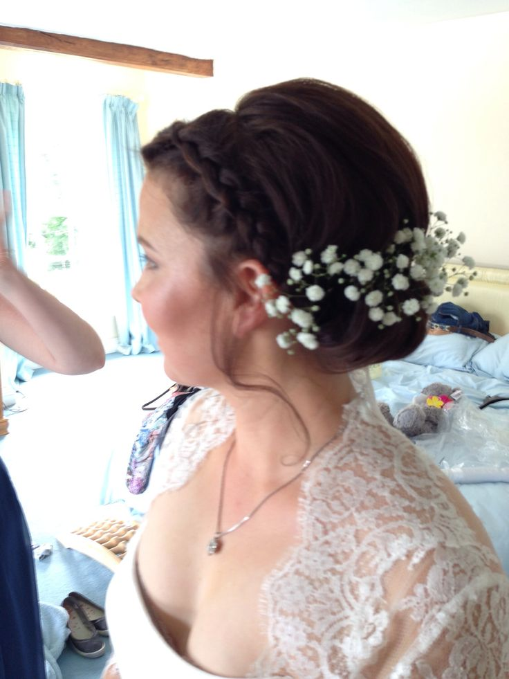 Plaits and a roll with gypsophila for wedding hair