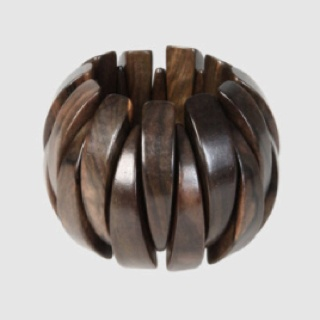 New Yorker Iris Apfel's Onion bracelet with kamagong wood sections £60 - as featured in yoox.com vintage >> I got mine for a tenner, 8 years ago!!!