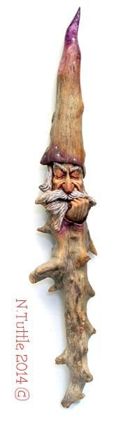 """""""Midnight Meditation""""   This restful wizard measures 20½ inches tall  and approximately 4 inches across his widest.  I don't know what type of wood this is other than Oregon  driftwood but it is a small tree with its tap root as the  wizard's beard and the trunk is his hat.  I've added a  little color using oil paints as a wood stain.     Signed and dated:  N. Tuttle 2/23/14"""
