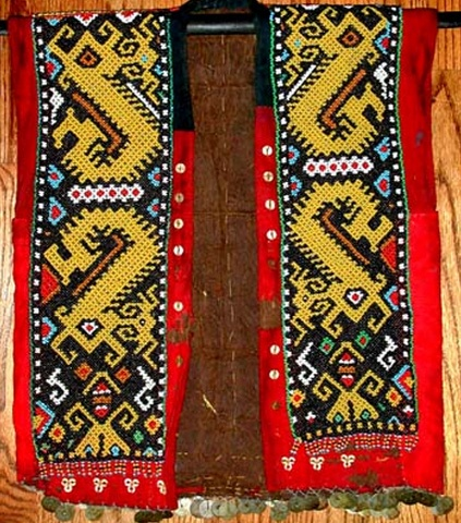 "KAYAN TRIBAL BEAD JACKET:  bead jacket is from the Kayan tribe of Sarawak.  The ""cloth"" is beaten bark"