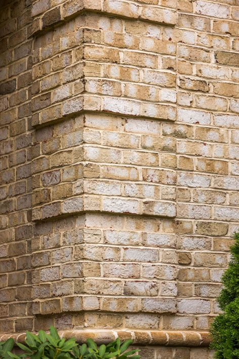 Quoin corners and water table brick design exterior - Exterior brick wall design ideas ...