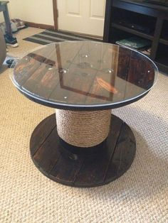 LOVE the wooden spool idea for The Admiral Benbow Inn. These would be on casters and we'd wouldn't need the glass top!!