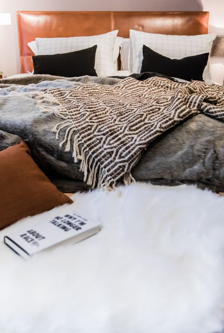 Houzz of 2018 - leather headboard and lots of cosy layers. Wall in Heartwood by dulux.