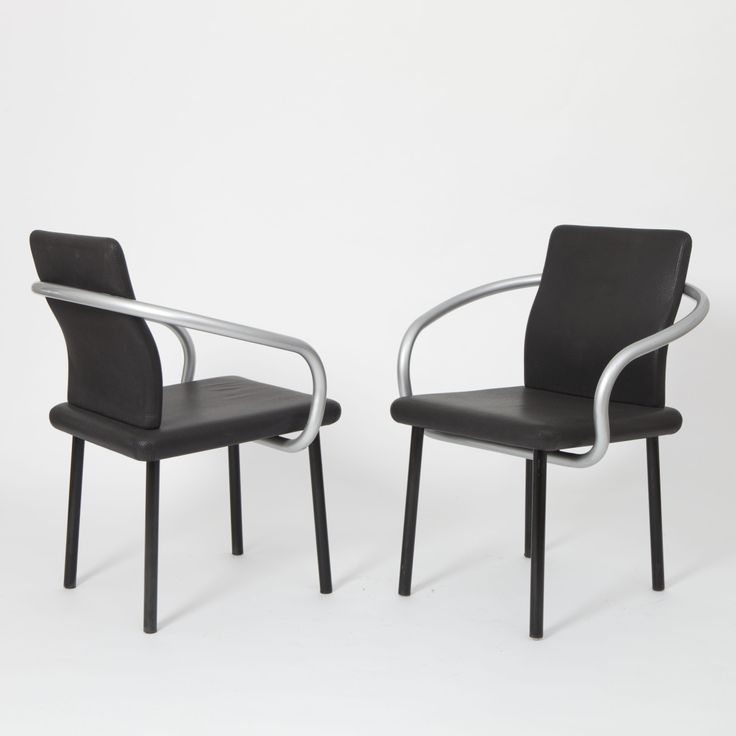 Designed by  ETTORE SOTTSASS Manufactured by  KNOLL  USA 1986  Set of 4 Mandarin chairs with black original upholstery designed by Ettore Sottsass for Knoll International in 1986. Also available in blue.  SIZE Seat height: 44 cm Total height: 82 cm Width: 66 cm Depth: 51 cm  STOCK 1 Available