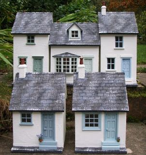 Julie's dolls house blog...love this blog. Tons of photos of finished cottages and buildings. She sells them on ebay...un decorated.